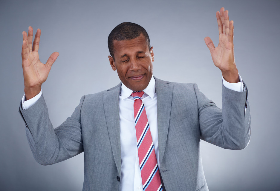Photo of businessman expressing success on grey background